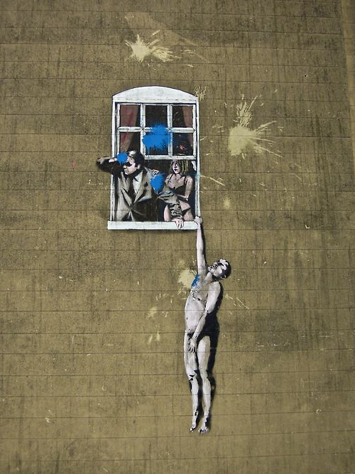 Banksy - Naked man hanging from window. Painted in 2006, Bristol city council decided to keep this piece after overwhelming support from the public. However recent reports on Banksy admitting he was a Bristol City fan (home colours red) which then their arch rival team, Bristol Rovers (home colours blue) fans decided to paintball his work in blue paint. As you can see the council tried to remove some of the paint. (Photographed on Park Street, Bristol February 2014) streetartbyla.com