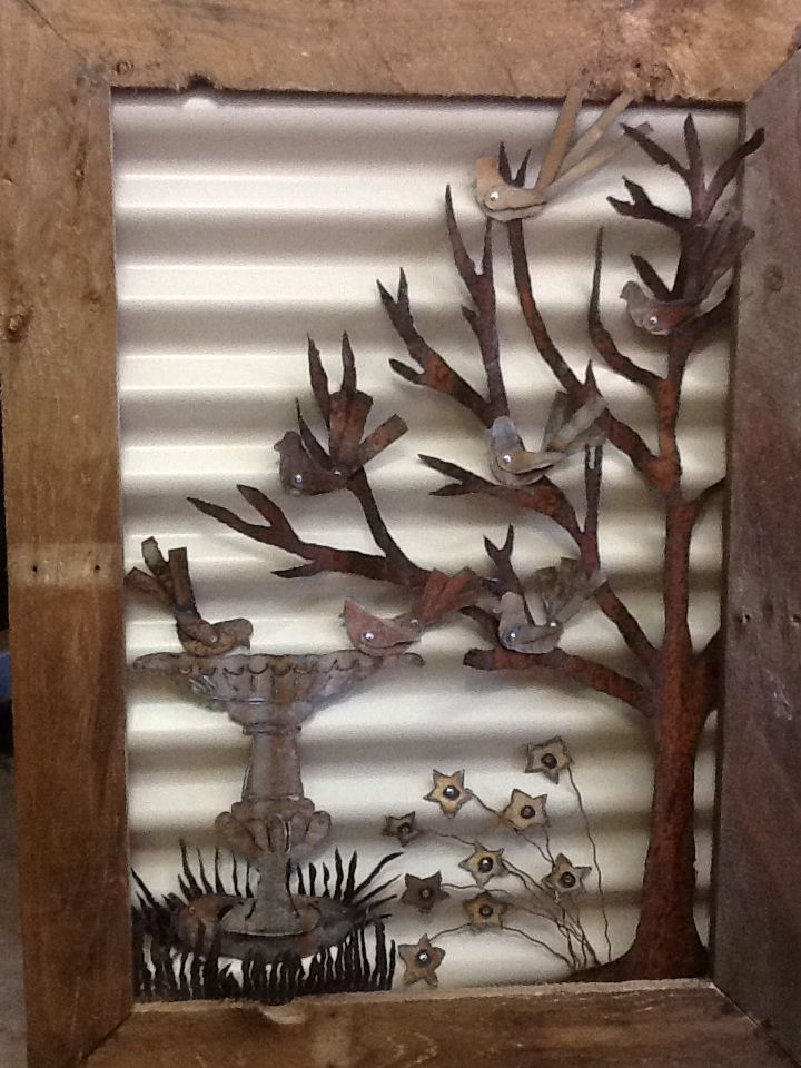 Bird bath picture made from Metal recycled fencing materials.