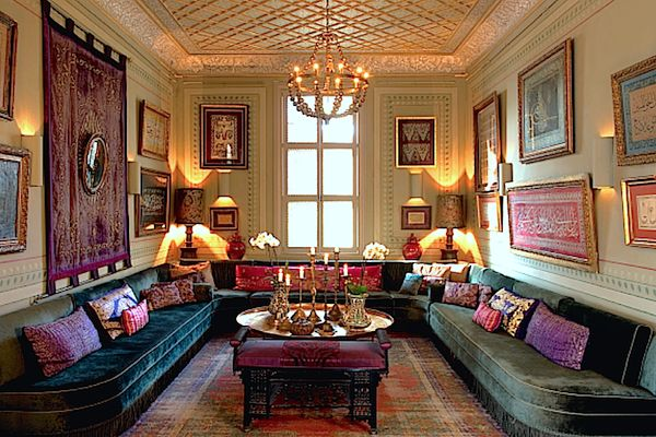 Ottoman Chic: one of Serdar Gülgün's alcove rooms, green velvet divans covered with a profusion of opulent silk, velvet and embroidered cushions wrap the walls hung with examples of Ottoman calligraphy, a graphic art form Gülgün feels is an ancient precursor to abstract painting. Sofas (actually originally a Turkish word) were never freestanding in Ottoman times as it was considered rude to sit with your back turned toward anyone.