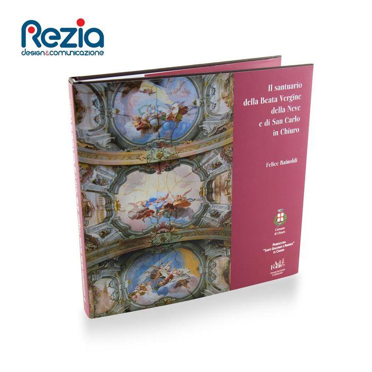 Libro con copertina rigida e sovracoperta dedicato alla Chiesa della Madonna della Neve e di San Carlo in Chiuro (SO)