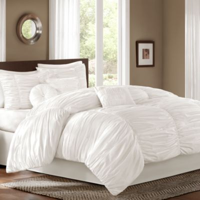Sidney 6-7 Piece Comforter Set - BedBathandBeyond.comThe Sidney bedding collection comes with everything you need for a soft and fluffy bed you can't wait to climb into. The top of bed features a billowing, ruched fabric, while the included decorative pillows spice things up with different shapes.