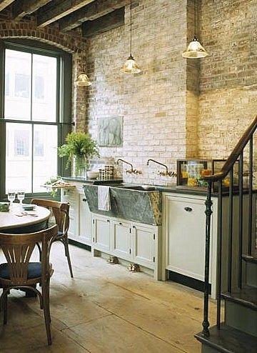 Floor-length windows, exposed brick, wide plank floor, upcycled vintage-looking sink