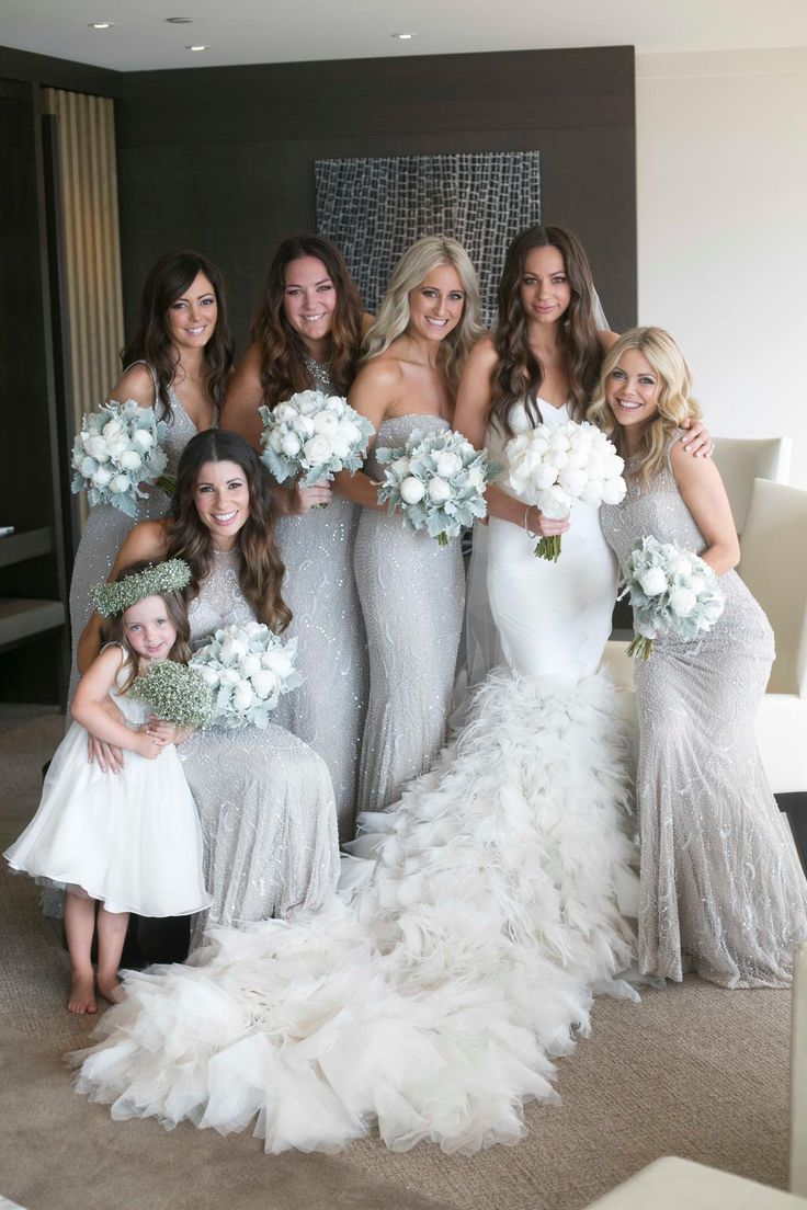 Absolutely gorgeous long silver bridesmaid dresses with some sparkle too! So stunning!