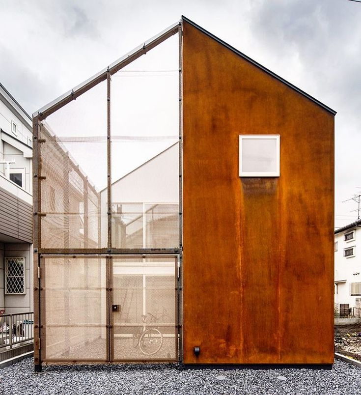 half metal screen, half corten metal, this is the façade of SUGAWARADAOSUKE's design for a house in chofu, tokyo. the dwelling is composed of semi-transparent, open and closed interior spaces inside.  more #architecture in japan on #designboom!