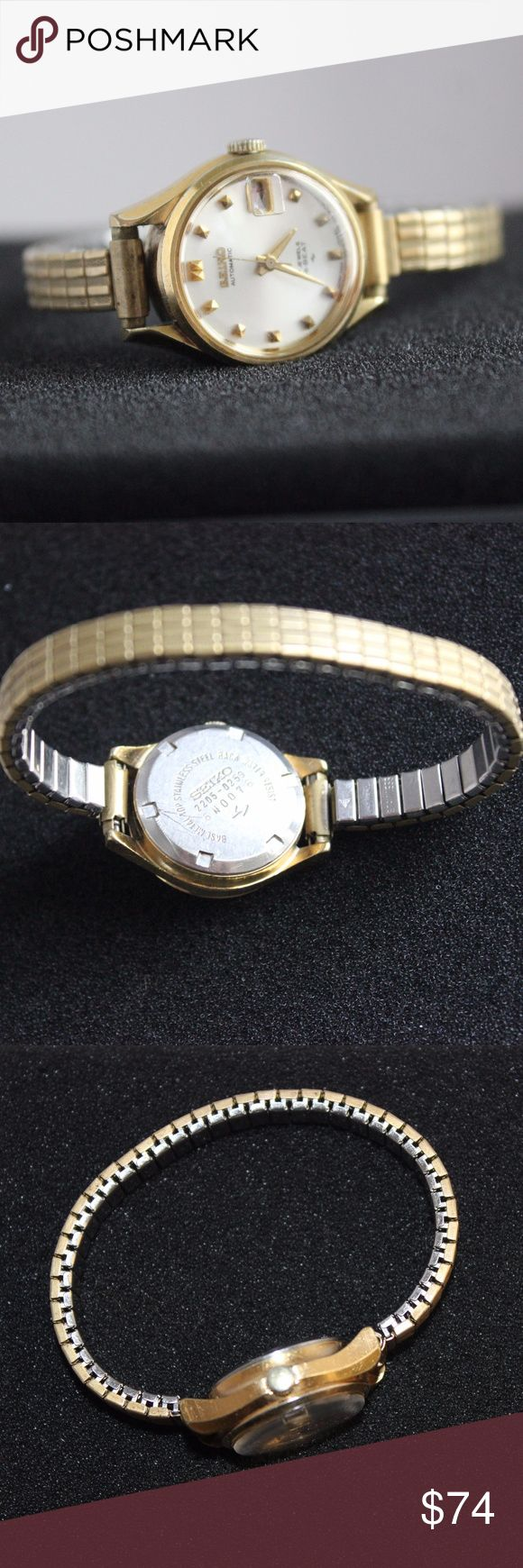 SEIKO AUTOMATIC GOLD WATCH Seiko Automatic Gold Watch. 17 jewels/Hi-beat. Date. Stainless steel back. Water resistant. Base metal top. #'s 2205-0259/6N0076. Stretch wrist band. Works great. Works with your pulse. Seiko Accessories Watches