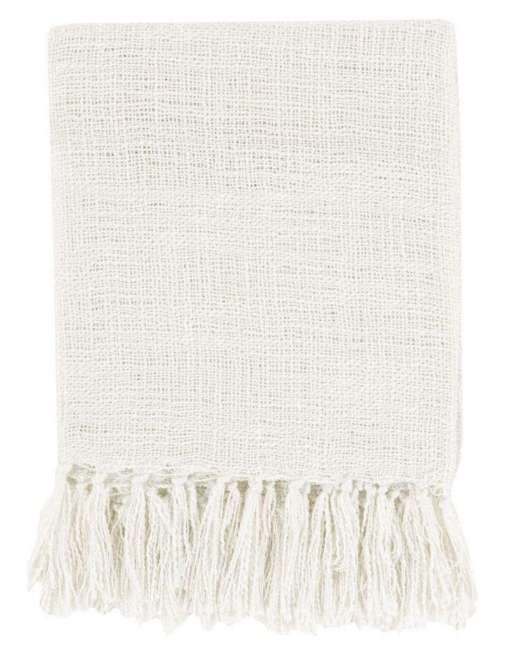 Our Belize ivory white throw blanket offers breezy style with loose weave pattern and long fringe. Woven from soft acrylic thread for durability, this throw is the perfect layering piece to add a fini