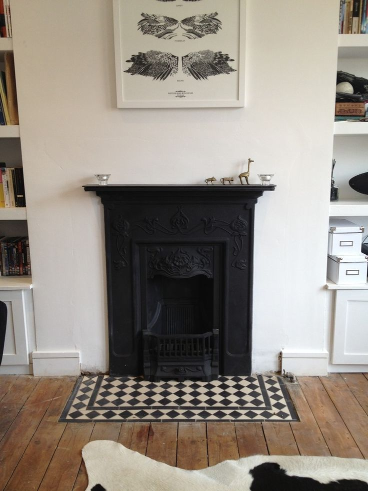 Dining room hearth could be re tiled in black and white as cohesive link to entrance hall. Or use white only off cuts from entrance hall cut to size if pattern too fussy.