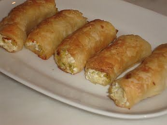 Leek And Cheese Rolls (Prasoboorekakia). These are easily prepared and tasty little rolls that you can have as a side dish on the table or as part of a buffet.