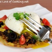 Mexican Tostada topped with a Poached Egg.   Bam. Mexican with a delicious egg.