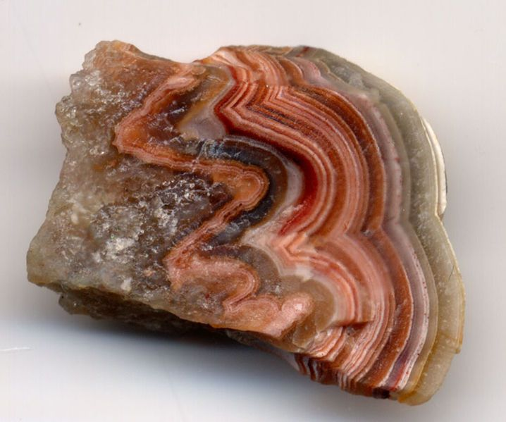 """Sardonyx is a variety of onyx which is typically """"striped"""" and can have the appearance of the """"rings"""" of a sawn tree-trunk, as can be seen in the topmost image. Sardonyx differs from regular onyx in that the dark bands are red or reddish brown, instead of black. The red bands are layers of sard, hence the name. It has similar general properties to onyx."""