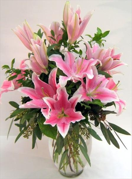 Fragrant Pink Lilies in a classic clear glass vase . Show the special someone how you feel about them with these flowers on your anniversary.