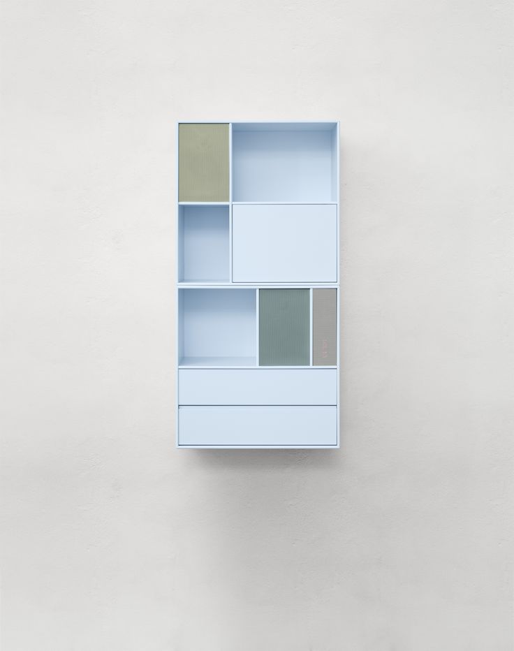 Wall mounted storage modules in a light blue. #montana