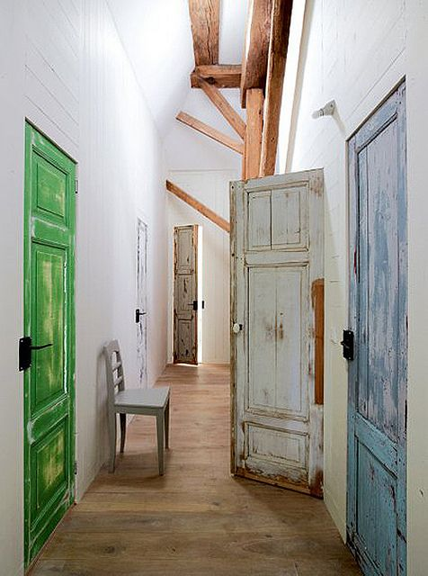 an old farmhouse in the dutch country side by the style files, via Flickr  I wanted to reuse old doors but couldn't because of building codes...after inspection you can tho!  HA!  Allowing ea room's occupant select the door color would get the same look and be a fun family memory.