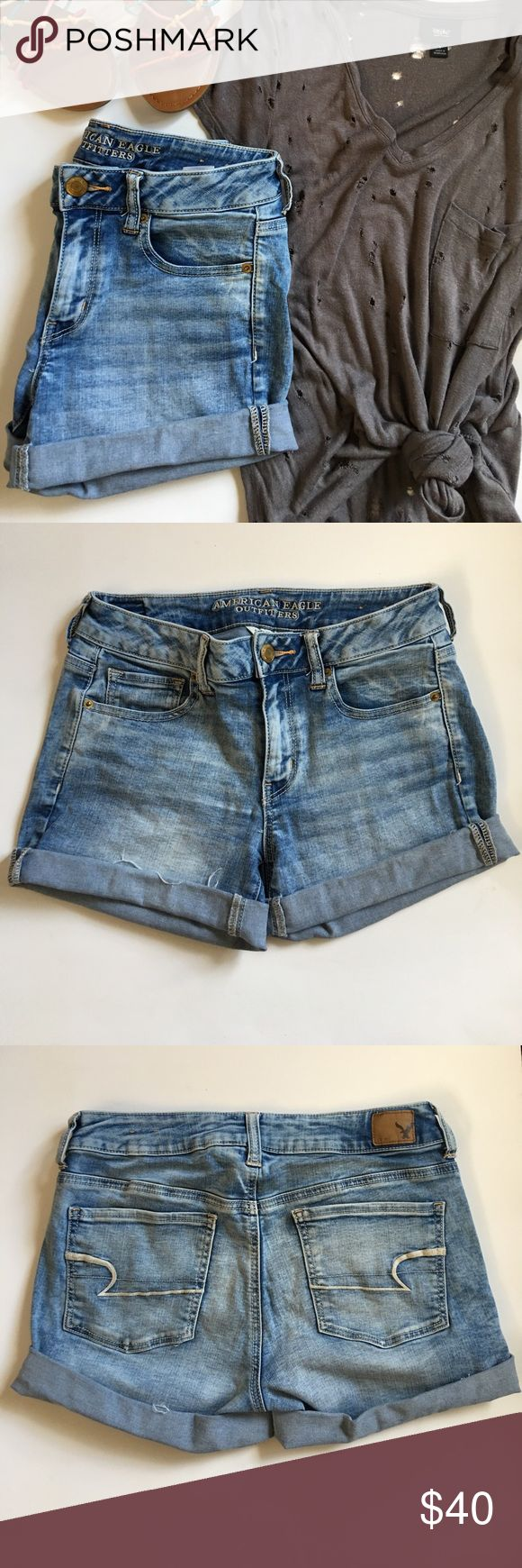 """AE Outfitters denim midi shorts AE Outfitters denim midi shorts. Size 8. Super soft and stretchy denim in a light, faded wash. Can also be worn uncuffed. Inseam is approx 6"""" uncuffed. Rise is approx 9"""". Waist measures approx 15"""" across laying flat. Cuff is semi-finished, but also has some factory fraying on the edges. Minor signs of wear on the bum stitching. American Eagle Outfitters Shorts Jean Shorts"""
