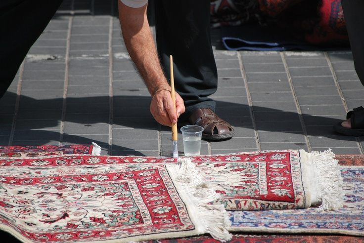 Painting the fringes of a rug in Jaffa near Tel Aviv