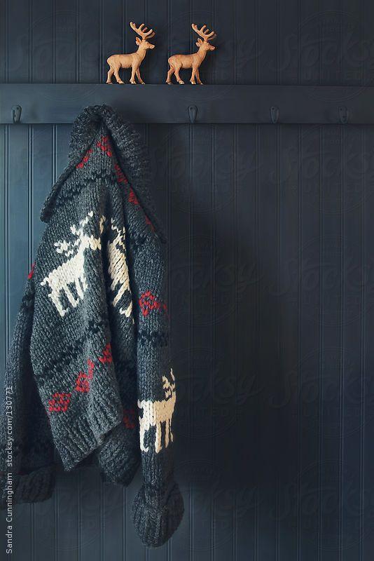 Vintage wool knit Cowichan sweater hanging on coak hook by Sandra Cunningham