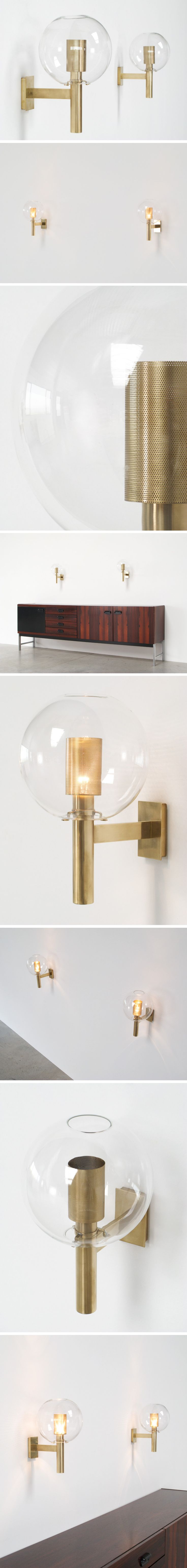 Set of 2 sconces light fixtures each featuring a clear glass globe with inside a brass body with perforated brass light diffuser Designed by Agne Jakobsson for AB Markaryd Creates a nice atmosphere of diffused light Ensemble de deux applique luminaires chacun avec un globe en verre transparent l int rieur une structure en laiton avec diffuseur en laiton perfore Con u par Agne Jakobsson pour AB Markaryd Cree une atmosph re agr able avec lumi re diffus e…