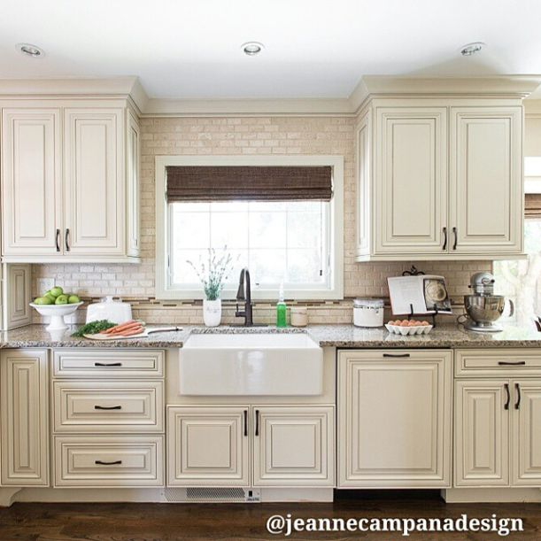 Love the look of these kitchen cabinets with brick wall and large white sink. Black stainless steel appliances would go perfect in this kitchen! Dream kitchen! #LGLitmitlessDesign #Contest