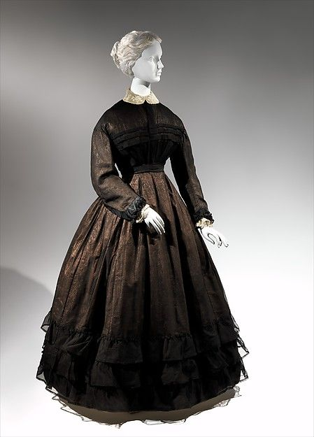 Mourning dress | The MET Date: ca. 1867 Culture: American Medium: cotton, silk Dimensions: Length at CB: 56 3/8 in. (143.2 cm) Credit Line: The Jacqueline Loewe Fowler Costume Collection, Gift of Jacqueline Loewe Fowler, 1982 Accession Number: 1982.256