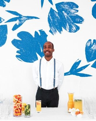 To create this bold backdrop for the bar, Blake reproduced the flowers from her original stamped design—she magnified them onto matte paper and printed using a large-format printer—then affixed the blooms to a wall with blue painters' tape.