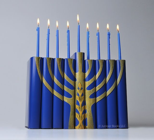 The Book Menorah concept is something that just hit me one day – the basic structure of a menorah lends itself perfectly to be re-envisioned with books.  Happy Hanukah everyone!