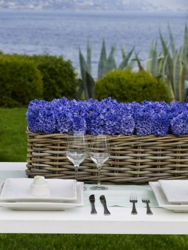 summer centerpiece basket full of blue hydrangea