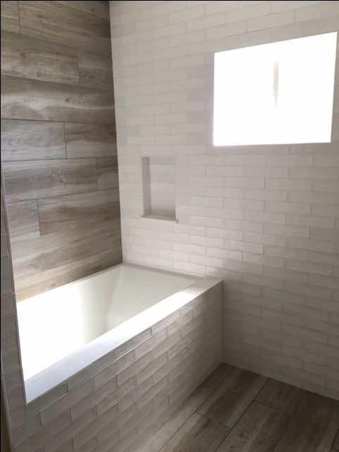 Porcelain wood and subway tile by Brent Jennings at Precision Tile