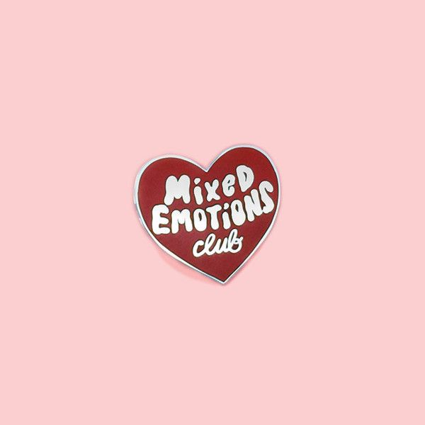 STYLE: erase you BE A PROUD MEMBER OF THE MIXED EMOTIONS CLUB WITH THIS TOMATO RED HEART PIN BY TUESDAY BASSEN AND FEEL AWESOME ABOUT IT. OR WEIRD. OR THRILLE