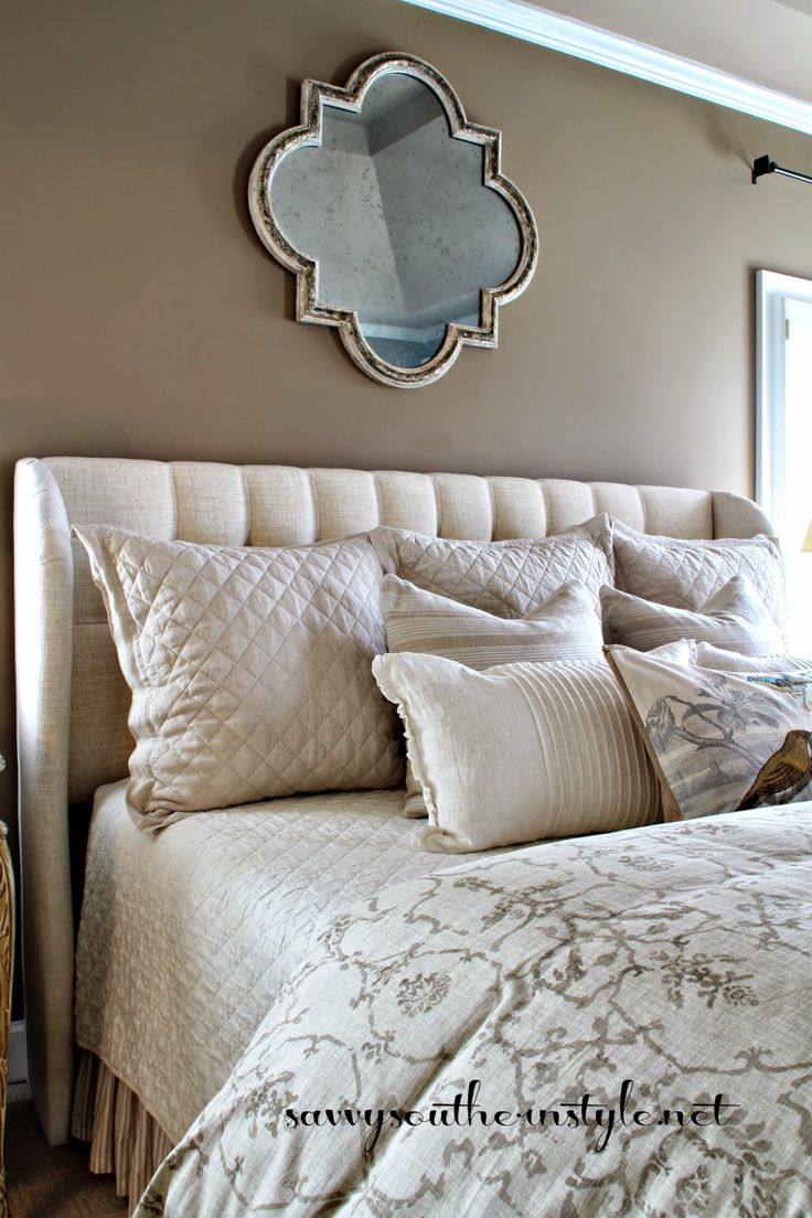 Neutral bedroom upholstered headboard tufted for Southern style bedroom
