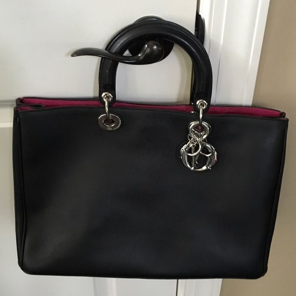 100% Authentic Large Dior Diorissimo Bag Beyond stunning!!!  Like new!  This is the largest version of this bag.Comes with long strap and pouch.  Black leather with pink interior leather.  Absolutely beautiful classic bag.  Also on Ⓜ️ for 2,000. Dior Bags Satchels