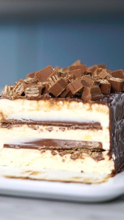 Crispy kit kat contrast creamy ice cream in this chocolate covered ice cream cake.