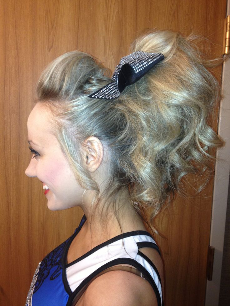cheer-is-religion:  imforeverunbroken:  My hair for day 1!  ive never seen AZ hair so big