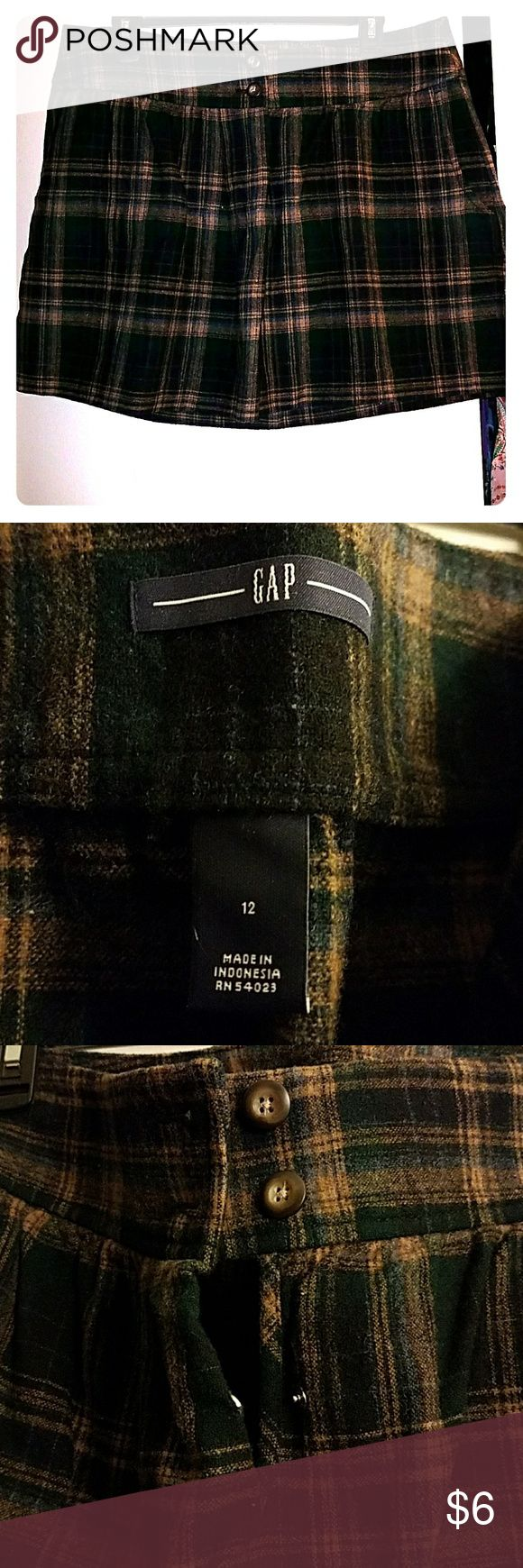 Gap Size 12 Plaid Wool Skirt with Pockets Gap Size 12 Plaid Wool Skirt, no inner lining, pockets, no zipper, button front. Only worn a few times, like new, Green/dark blue/black/tan/orange are the colors of the plaid. Im 5'4, skirt is a few inches above knee GAP Skirts