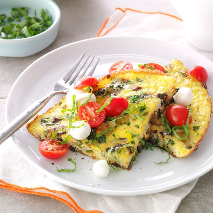Full Garden Frittata Recipe -I was cooking for a health-conscious friend, and wanted to serve a frittata. To brighten it up, I added leftover bruschetta topping and fresh mozzarella. Now that's breakfast. It's become a favorite among my friends and family, and a staple in my recipe book. —Melissa Rosenthal, Vista, California