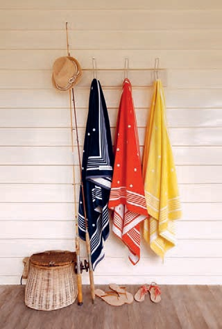 Home from the beach or lake...hooks instead of clothesline to dry towels.  Place on side of home where they get the most sun