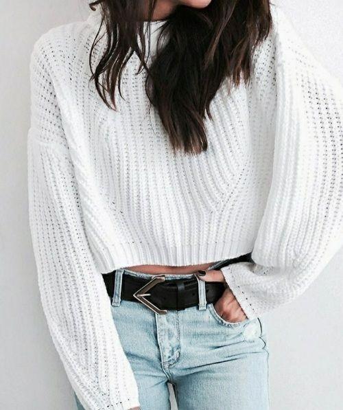 White knitwear on faded blue jeans