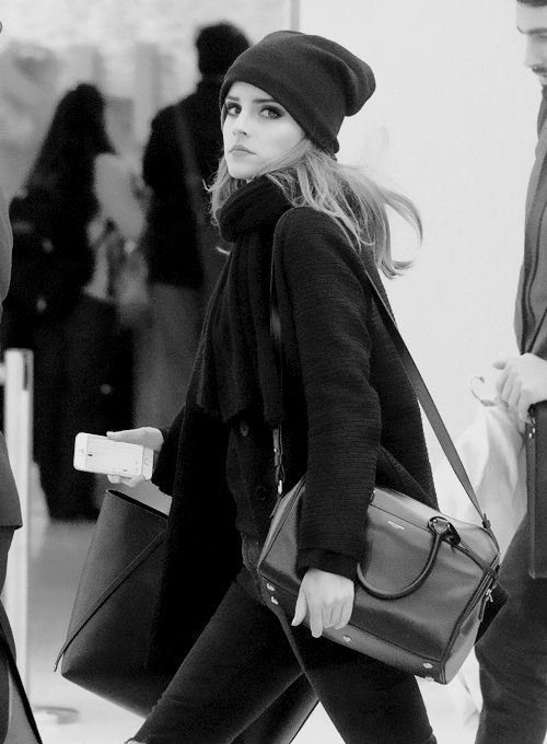 Emma Watson  Looks like its from a photo shoot when she is actually catching a plane.