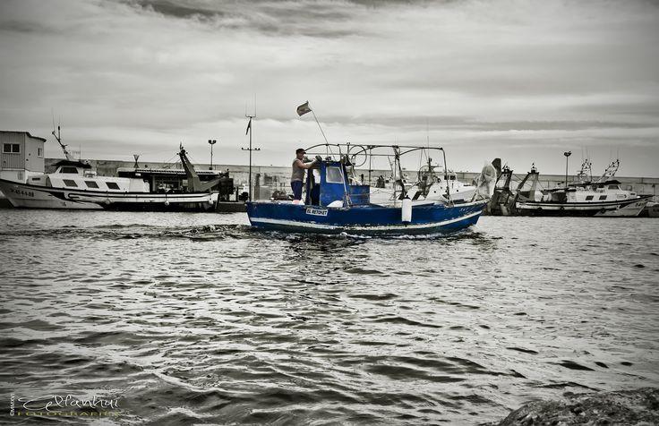 El Retoret - Selective cutout on a fisherman and his boat.