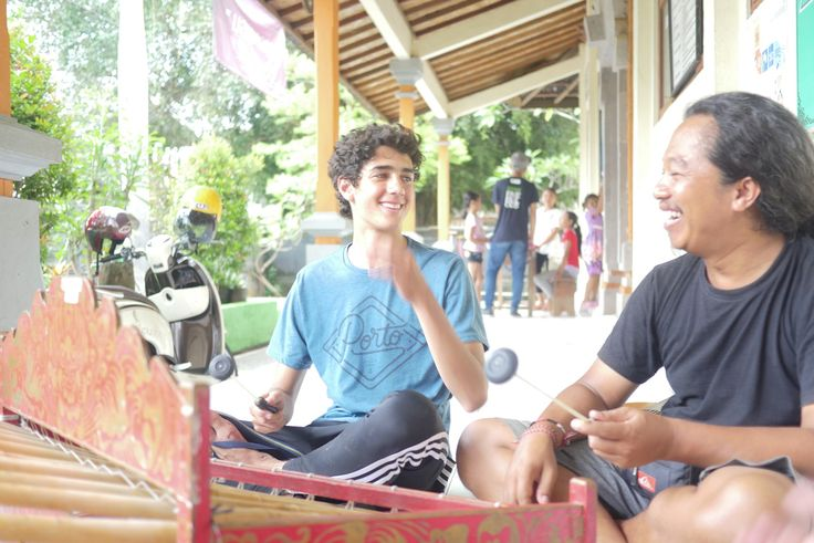 Our #local staff member Wayan is teaching our volunteer Eduardo to play the Gamelan, a #traditional Balinese instrument. #vpbali #culture #inspire #bethechange