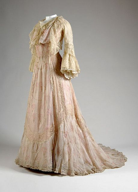 Charles Frederick Worth Teagown France, c. 1900 Printed white silk gauze, silk chain stitch, white lace Worn by Mrs. Colin Powys, née Nancy ...