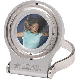 Say it in style with this distinctive desk clock and photo frame. Made from solid metal, Synergy features a multi-rotational display and folds flat for storage or travel. A timeless design. http://catalogue.davarni.com.au/Products/Search/Products?category=12249