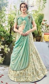 Green Color Silk Embroidered Lahenga Choli #lehengadesignimages #lehengamaterial Look trendier than your friends in this green color silk embroidered lahenga choli. The brilliant attire creates a dramatic canvas with lace work. Upon request we can make round front/back neck and short 6 inches sleeves regular choli blouse also. USD $ 245 (Around £ 169 & Euro 186)
