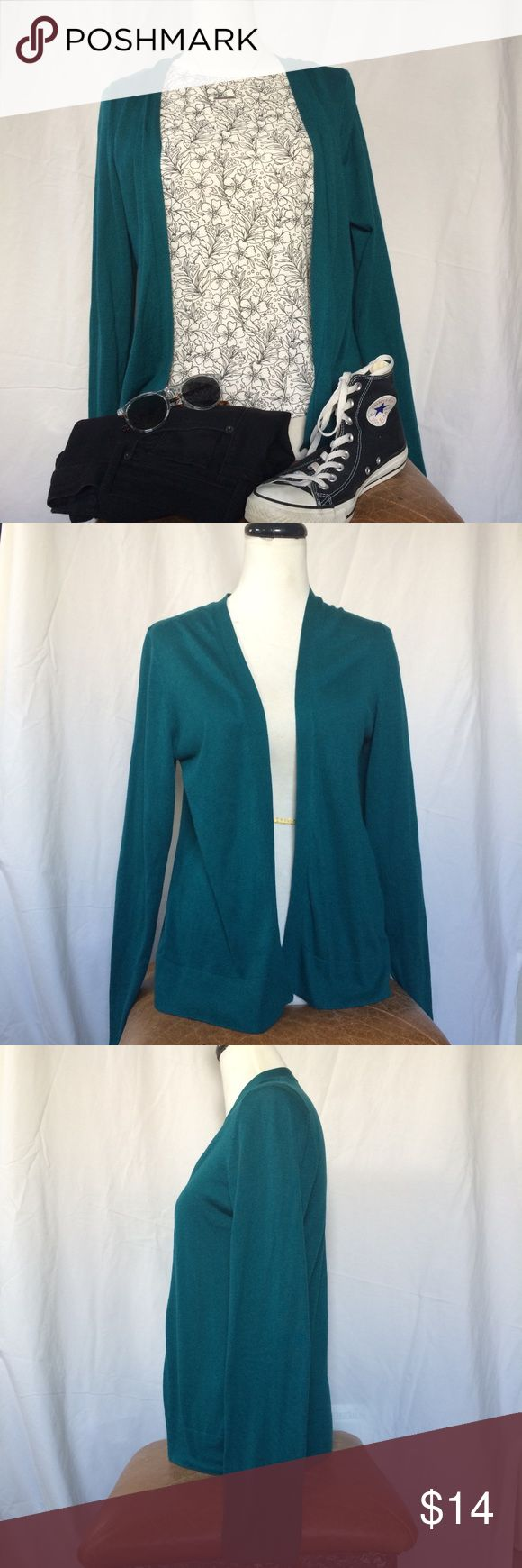 Soft & Cozy Teal Cardigan Only worn once. Perfect condition except for cut off material tag.   A soft, comfy cardigan in a beautiful deep teal color. Material is smooth and soft, not too heavy but not lightweight either. Perfect for spring days and cool summer nights.   Size large, fits true to size. See measurement pics for details.   Accessories not included. Cardigan only, but flower shirt is for sale separately. Old Navy Sweaters Cardigans