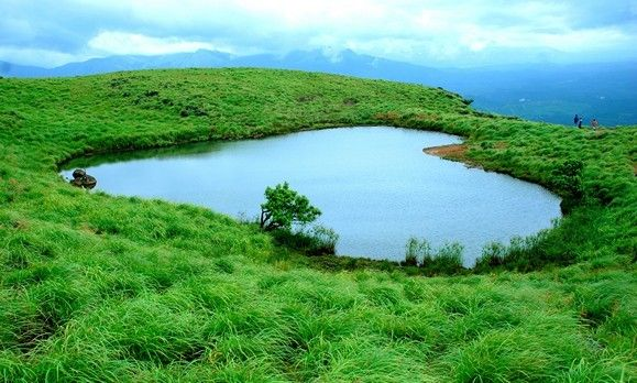 Chembra Lake, Kerala, India  Natural Heart Shaped Lake on the highest peak in Wayanad) Kerala India.The lake is believed to have never dried up.
