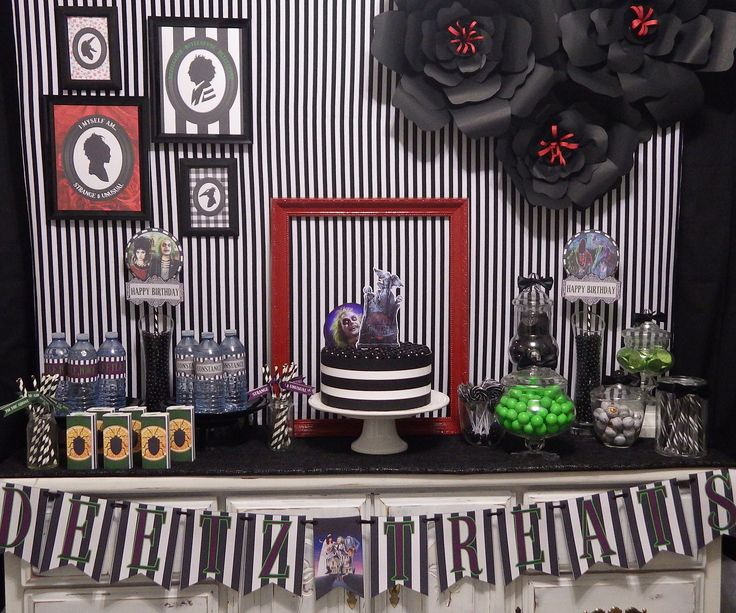 Beetlejuice Party table set up by Epic Parties by REVO.  Printable found in our Etsy shop!