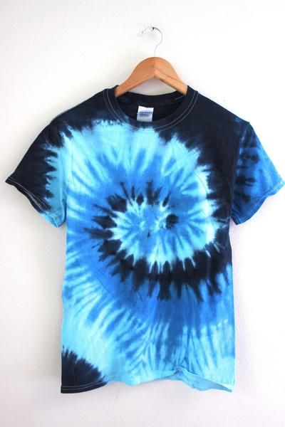 Navy blue, medium blue and baby blue ocean inspired swirls tie-dyed t-shirt. 100% cotton. Please note: Each tie-dyed tee is hand dyed and slightly unique.  Wa