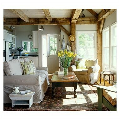 White sofa, farm style coffee table, small white bench...and wooden beams...love!