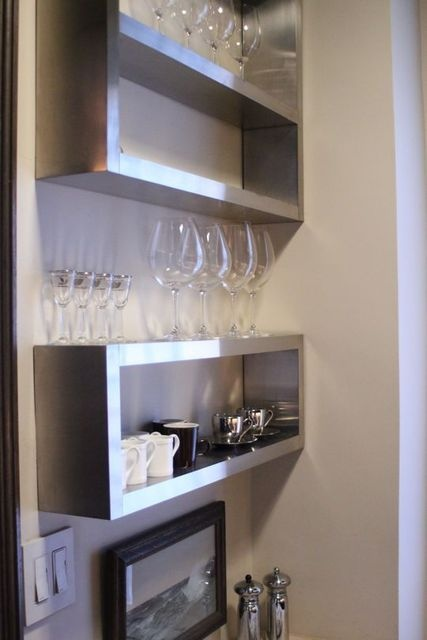 My beautiful handblown glassware is too tall for my rental cabinets. This is a great idea to display them and store them! John Eason NY House Tour