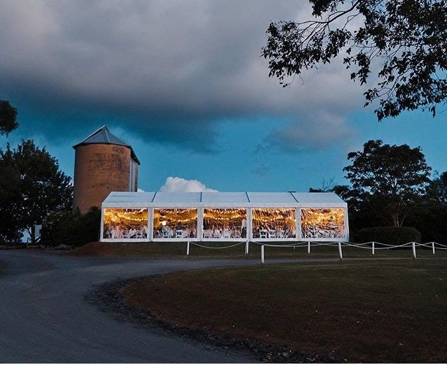 Silos and lit up marquee from South Coast Party Hire  #countrywedding #rusticwedding #winerywedding #silos #marqueewedding #marquee #lights #clearmarquee