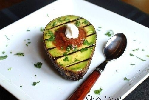 Grilled Avocado filled with salsa and sour cream.